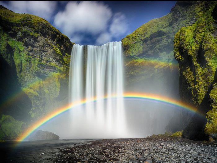 pastel rainbow wallpaper digital drawing of waterfall falling from tall rocks two rainbows underneath