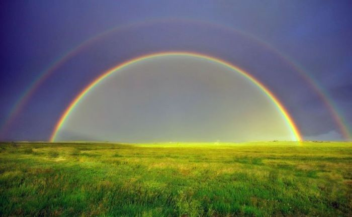 photo of a field covered with green grass blue sky above it cute rainbow wallpaper two rainbows in the sky