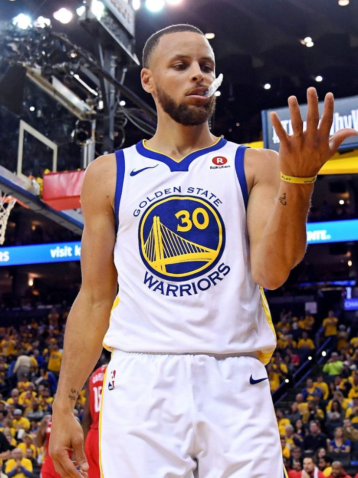photo of steph looking at his hand wearing white warriors uniform stephen curry wallpaper hd