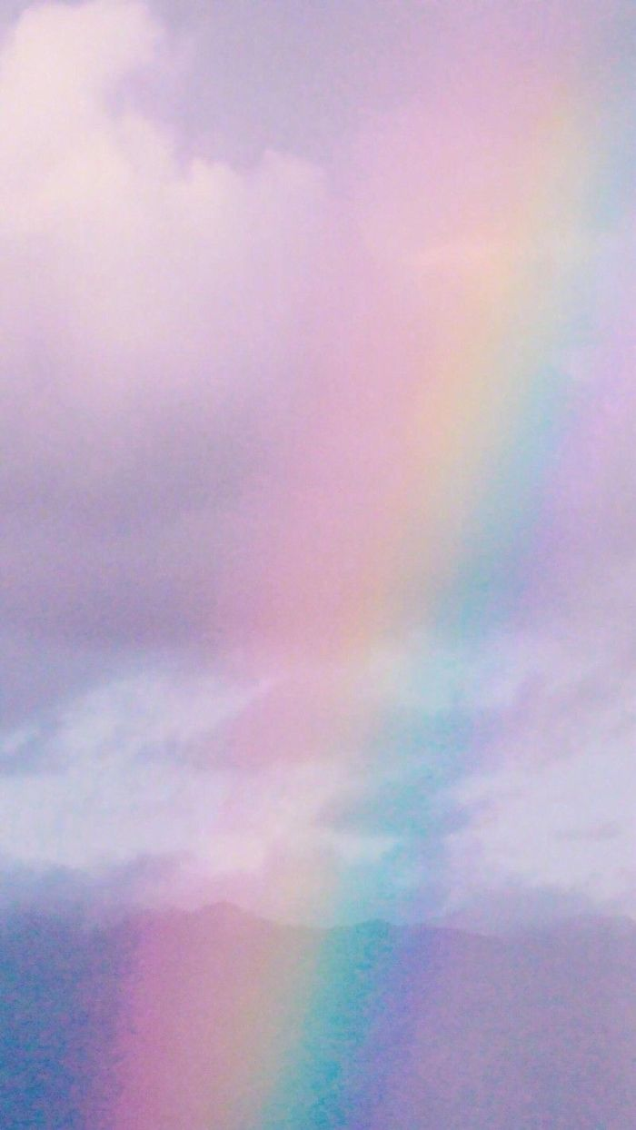 photo of the sky filled with clouds cute colorful wallpaper rainbow going through the photo
