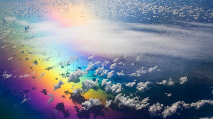 photo taken from above the clouds over ocean boho rainbow wallpaper rainbow under the clouds