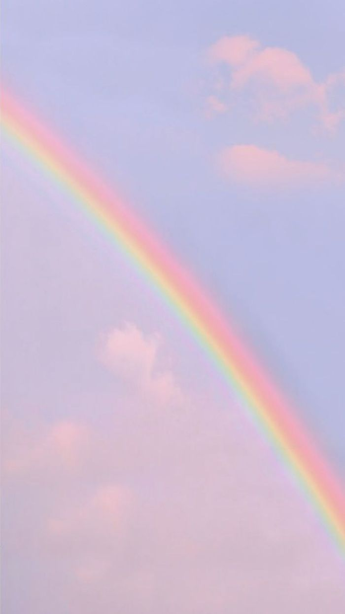 pretty color backgrounds photo of the blue sky with a few clouds rainbow going through it