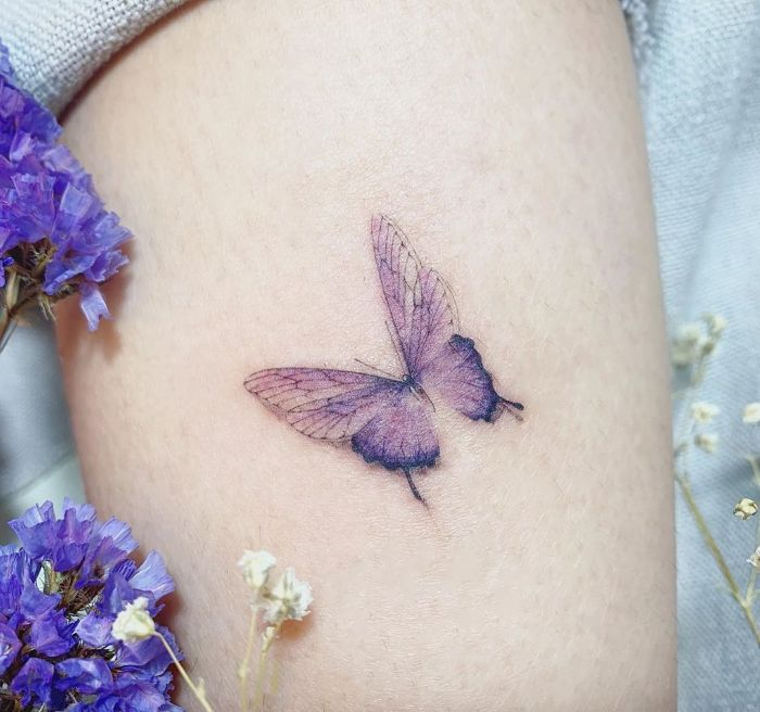 purple butterfly watercolor tattoo butterfly hand tattoo thigh tattoo two purple flowers on the side