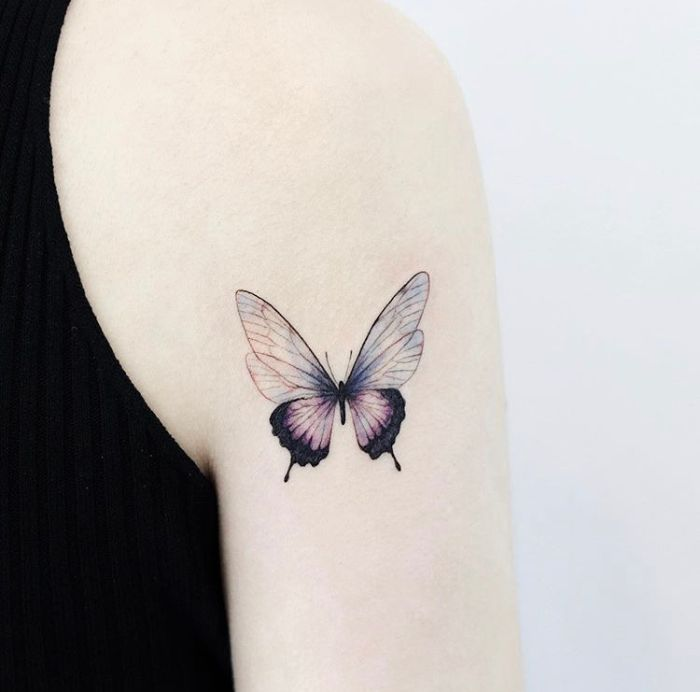 shoulder tattoo on the back of the arm simple butterfly tattoo half purple half blue butterfly