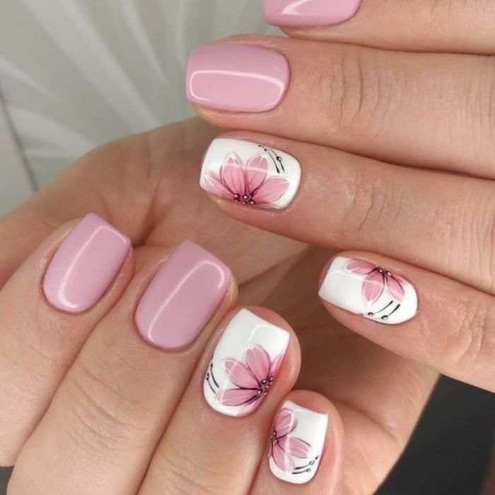 simple nail designs pink and white nail polish pink flower decorations on ring and pinky fingers