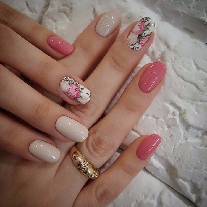 spring nail colors 2021 pink and light gray nail polish floral decorations on middle and ring fingers on almond nails