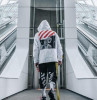streetwear fashion man wearing all off white outfit white hoodie black pants black sneakers