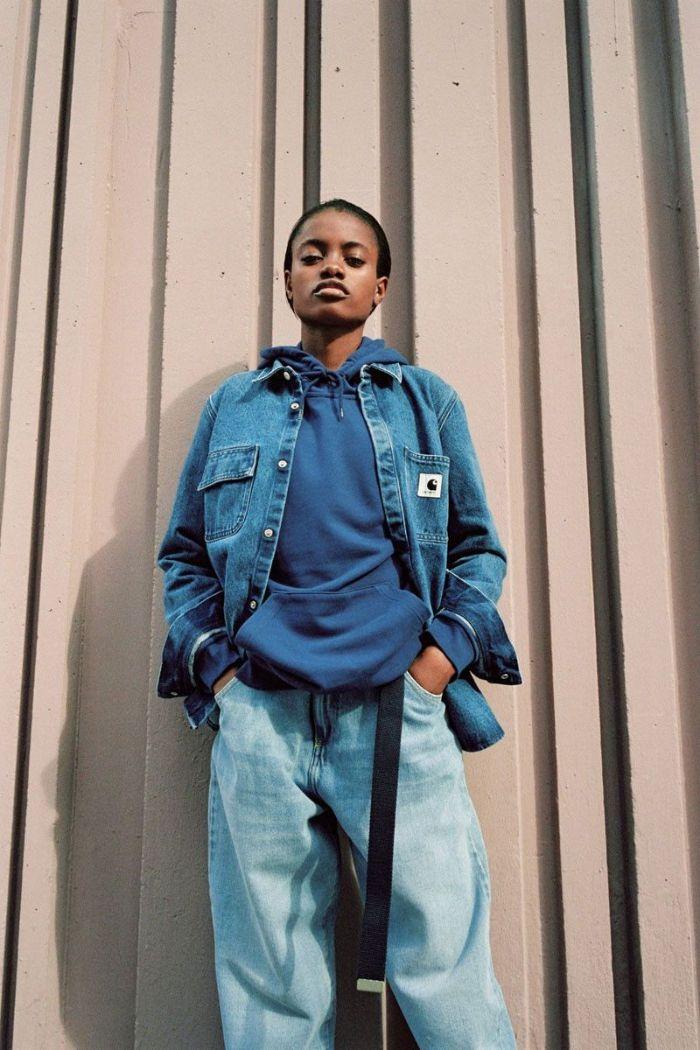 streetwear style woman wearing oversized jeans blue hoodie denim jacket