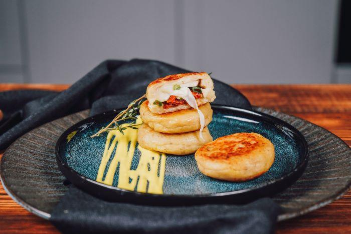 stuffed potato bites placed on blue ceramic plate appetizer recipes with sun dried tomatoes mozzarella