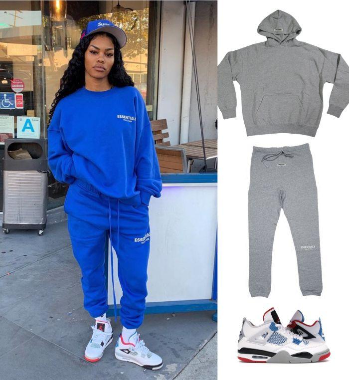 teyana taylor wearing blue essentials tracksuit with white air jordan sneakers mens urban clothing blue supreme hat