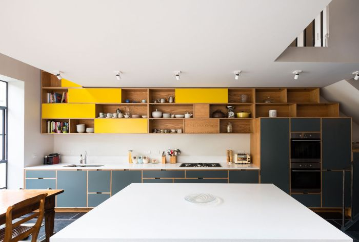 tiled floor in kitchen with black bottom cabinets kitchen with shelves instead of cabinets with yellow accents