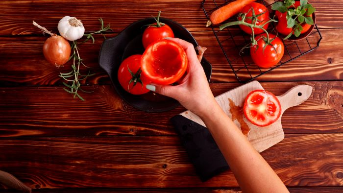 tomatoes with their insides taken out easy appetizers for a crowd placed in black bowl