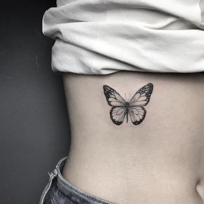traditional butterfly tattoo black and white butterfly tattoo on the side of the rib cage