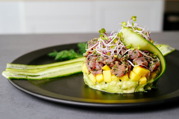 tuna tartare recipe with mango sprouts avocado cucumber appetizers for a crowd on black plate