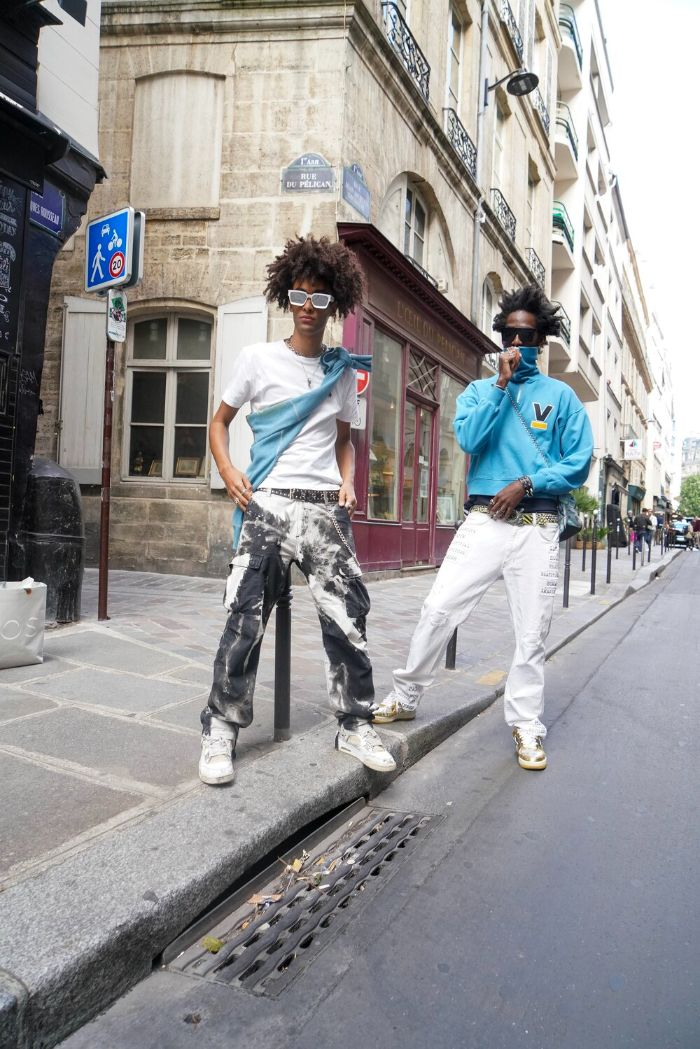 two men standing on the street streetwear clothing wearing different outfits