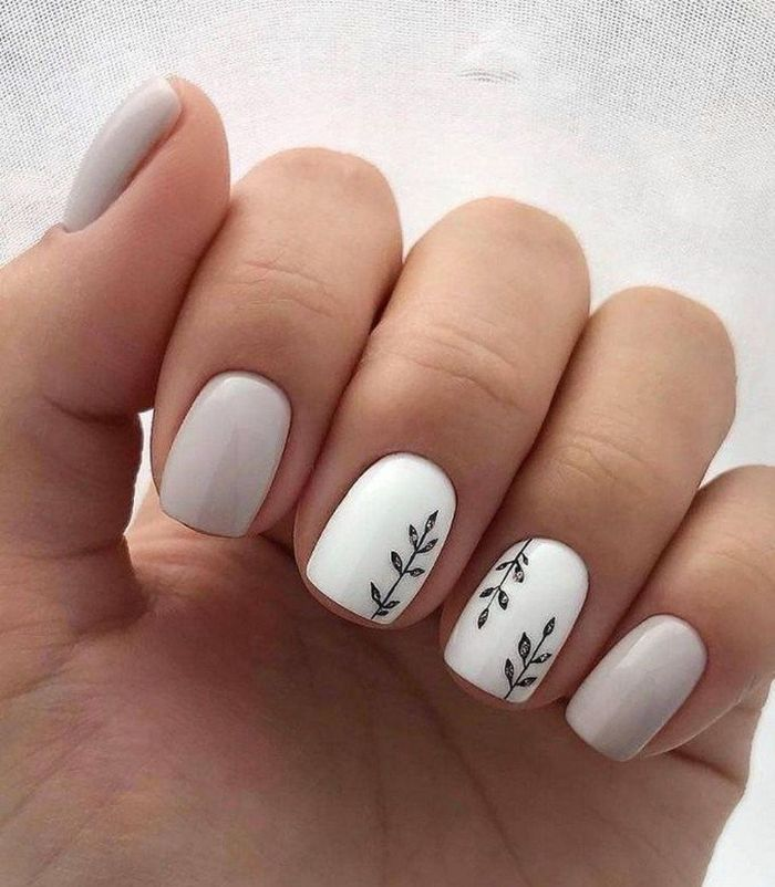 white and gray nail polish simple nail ideas small decorations of branches on ring and middle fingers