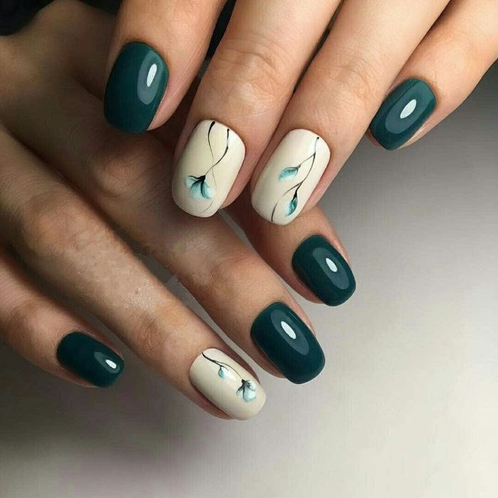 white and green nail polish simple nail designs flower decorations on middle and ring fingers