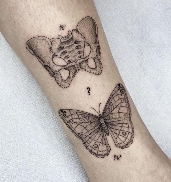 white background two butterflies skull and regular butterfly tattoos on shoulder scientific tattoo