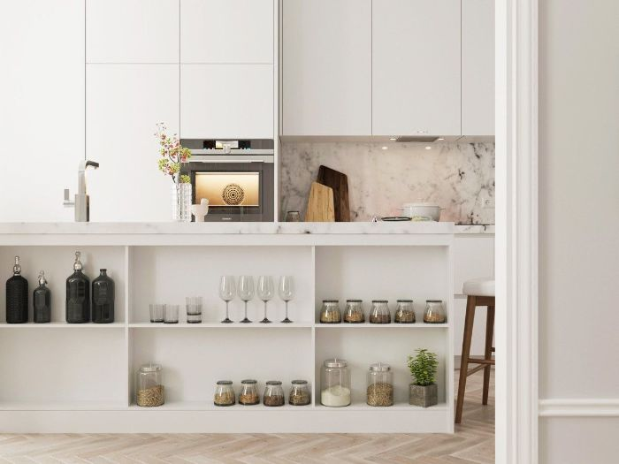 white cabinets and kitchen island open shelving kitchen marble backdrop wooden floor