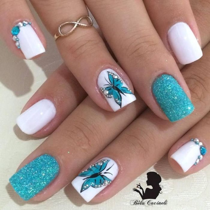 white nail polish base blue glitter blue rhinestones and butterflies decorations nail designs for short nails