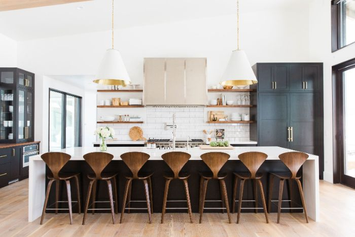 white subway tiles backdrop with wooden shelves wood floating shelves kitchen black kitchen island with white countertop