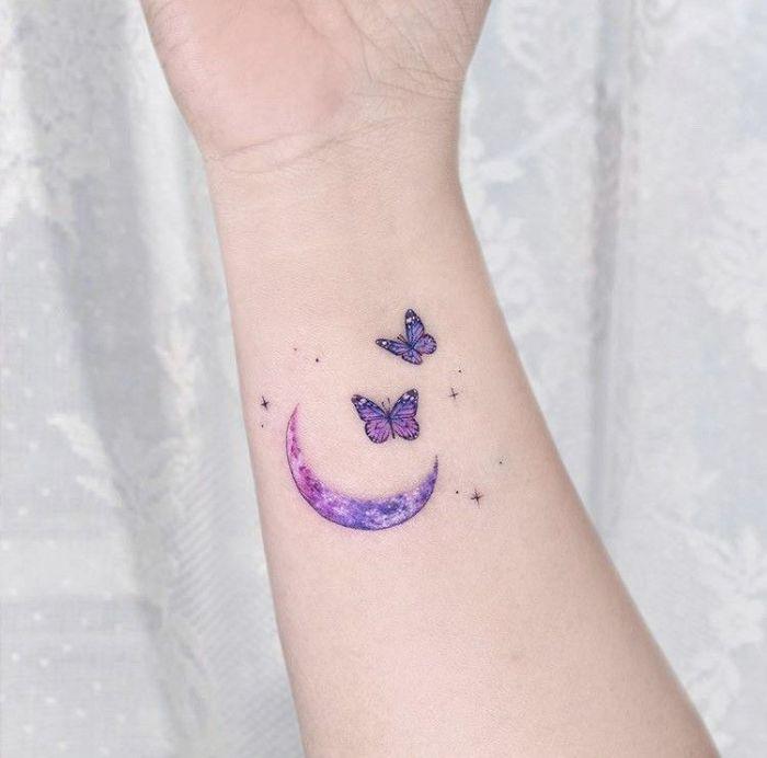 wrist tattoo butterfly tattoo on arm two small purple butterflies purple crescent moon stars