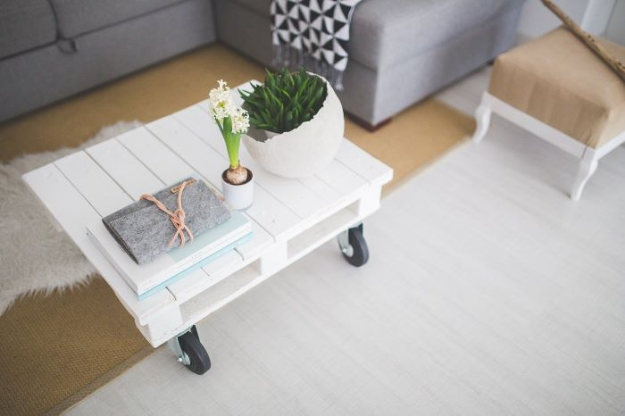 scandinavian style interior ideas to use in your interior white wooden table on wheels gray corner sofa minimalistic design