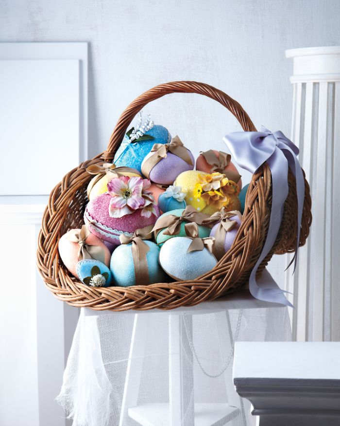 adult easter basket large basket filled with eggs in different colors wrapped with bows