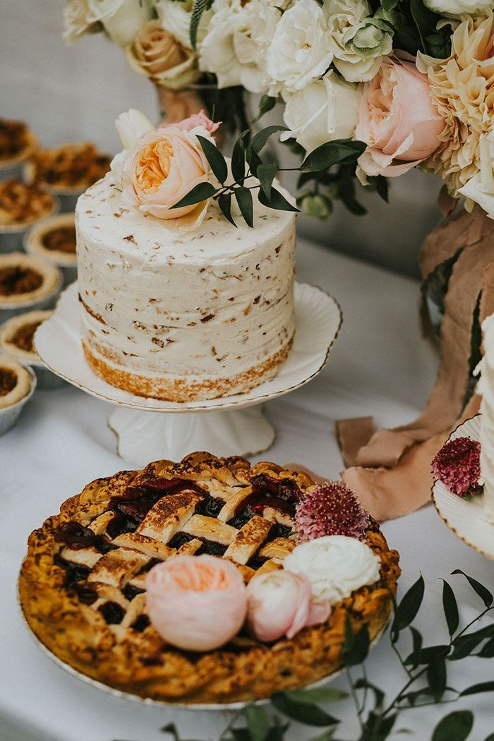 backyard wedding ideas dessert table with cake covered with white frosting and apple pie
