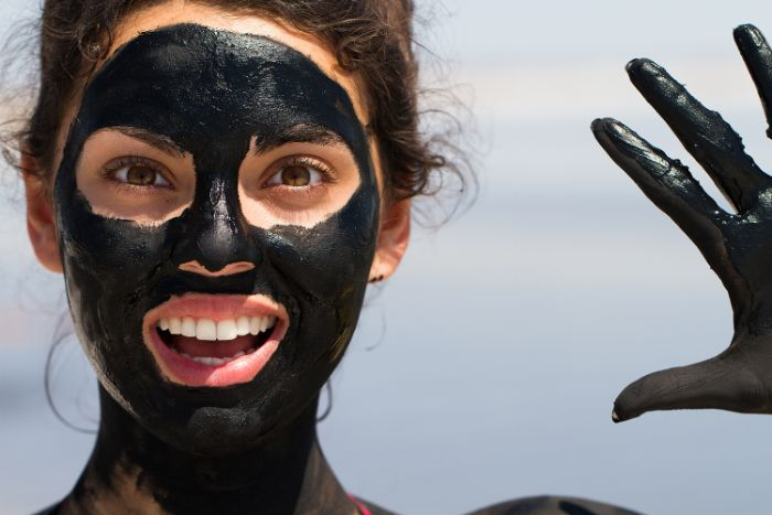 black face mask diy face mask for acne woman with brown curly hair