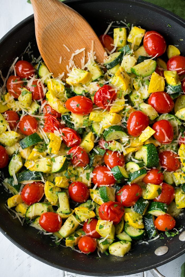 black skillet squash recipes zucchini squash and cherry tomatoes cooking with grated parmesan cheese