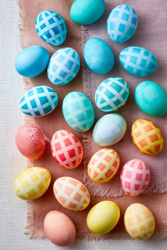 blue orange yellow pink eggs with fun pattern how to dye easter eggs placed on pink table cloth