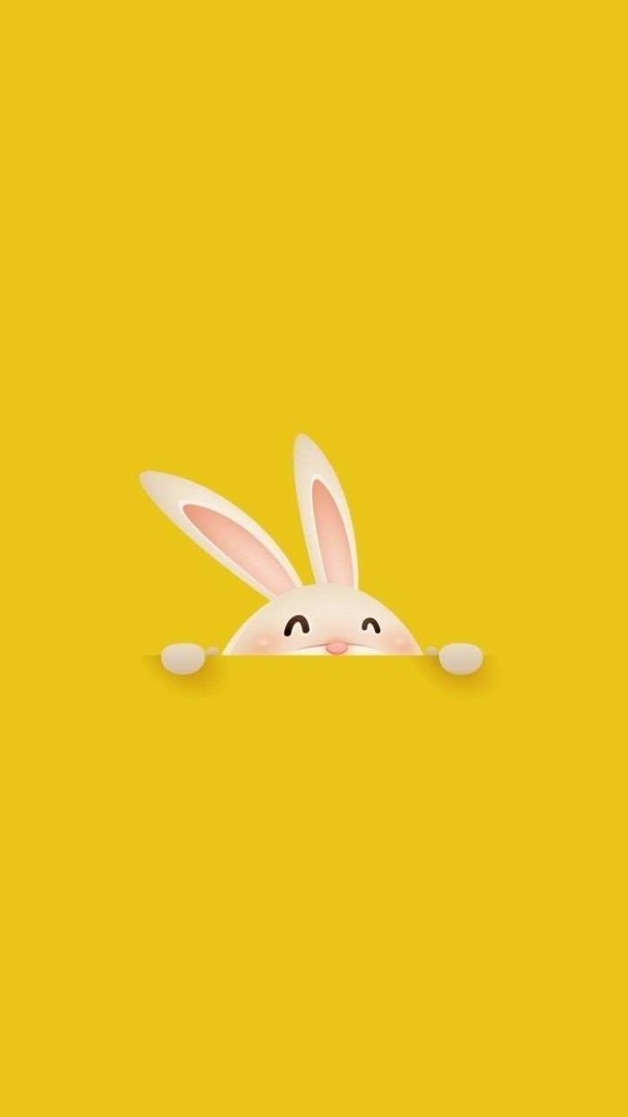 bunny in the middle coming out of a pocket easter bunny background yellow background