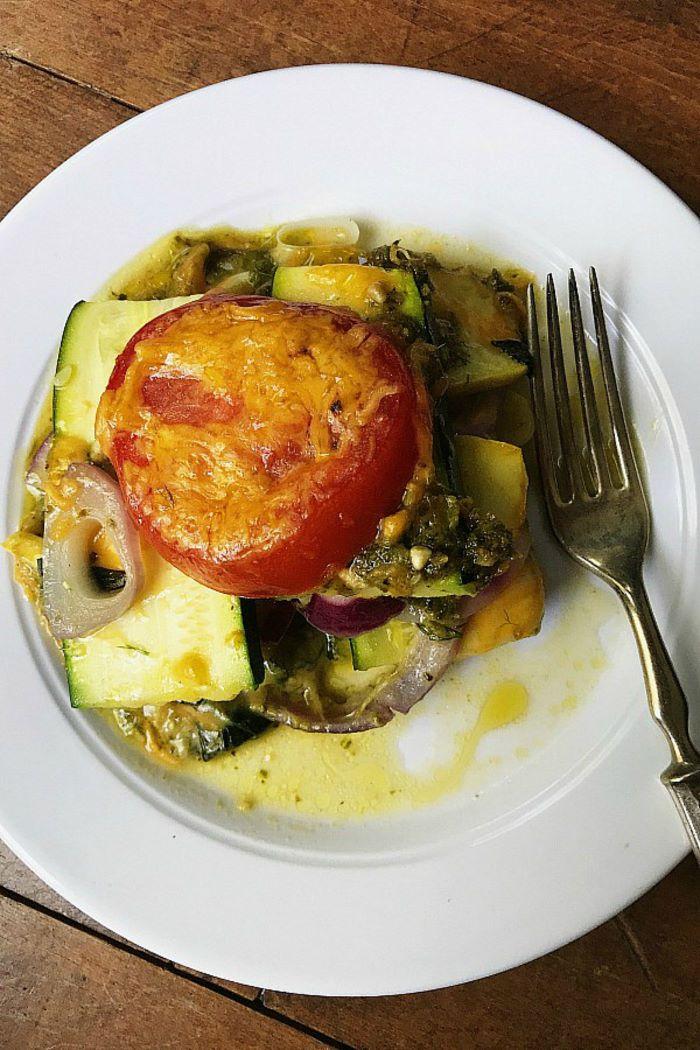 casserole with squash zucchini tomatoes onion parsley zucchini and squash recipes on white plate