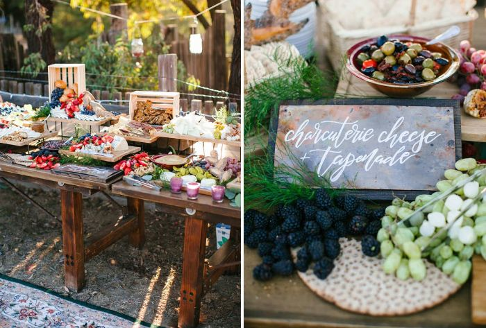 charcuterie table with different types of cheese fruits veggies dips bread backyard wedding ideas