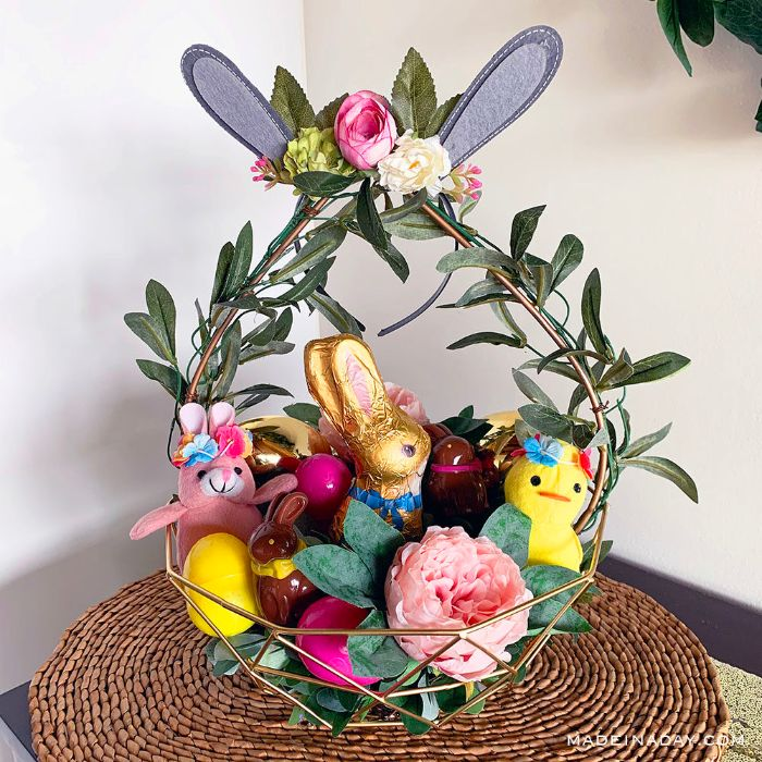 chocolate bunnies stuffed toys easter basket ideas inside metal basket decorated with flowers