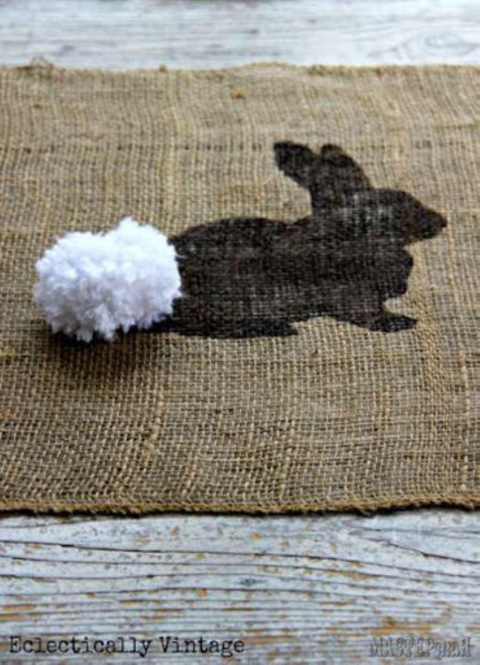 close up photo of bunny pattern with white pom pom for tail easter table décor diy easter table runner