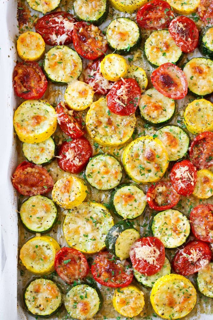 close up photo of zucchini squash and tomato slices how to cook yellow squash garnished with cheese