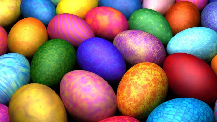 colorful eggs with different patterns and in different colors easter background arranged together