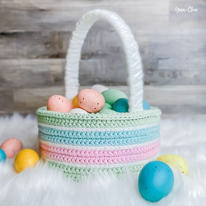 crocheted basket in green blue and pink adult easter basket decorated easter eggs inside