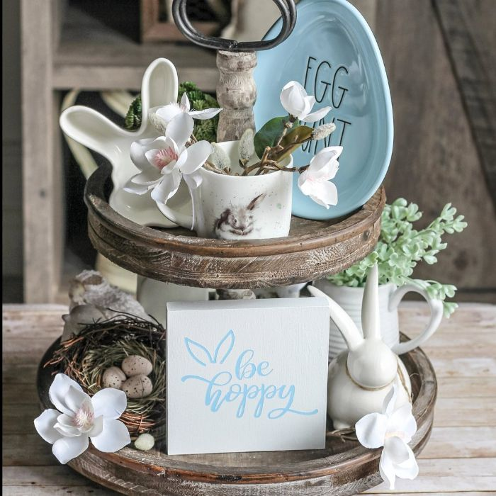 cupcake stand decorated with easter themed ceramic figurines easter decoration ideas faux flowers