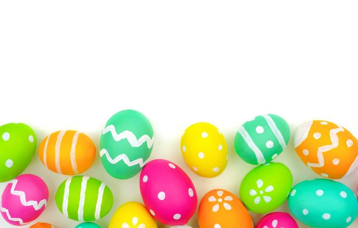 cute easter wallpaper lots of eggs in different colors with different patterns on the bottom of the photo on white background