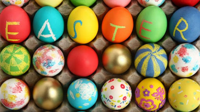 decorated eggs in different colors and patterns spelling easter dying eggs with food coloring