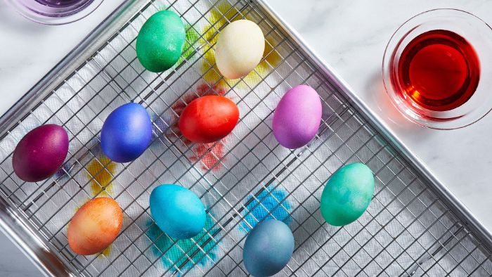 decorated eggs on metal rack dying eggs with food coloring dyed in green blue purple red