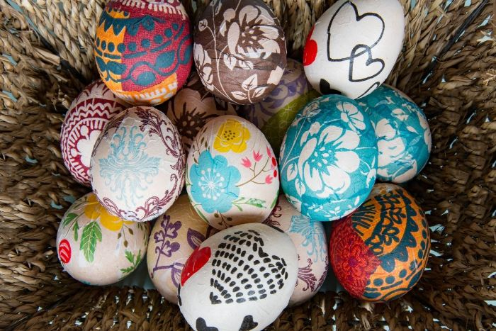 decoupage easter eggs placed inside a basket easter egg coloring colorful eggs