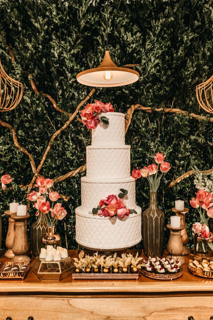 dessert table four layer cake decorated with pink roses and tulips simple wedding decorations