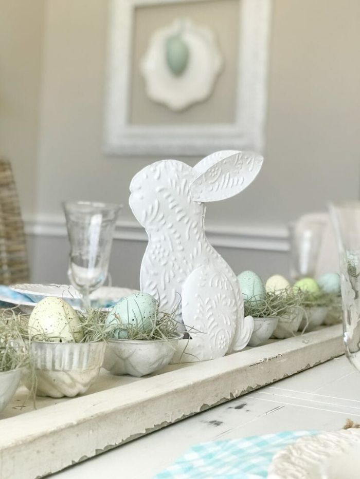 diy easter decorations white ceramic bunny in the middle bowls with eggs in nests