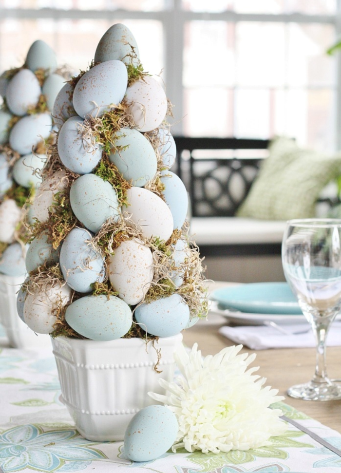 diy tree topiary easter decorations 2021 made with blue and white eggs and moss in white ceramic pot