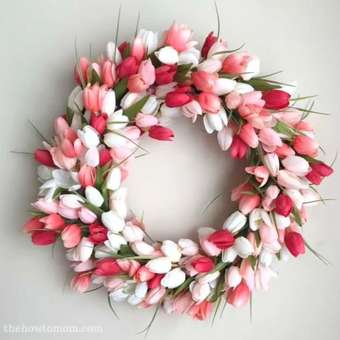 diy tulip wreath easter crafts for adults made with tulips in different shades of pink and white