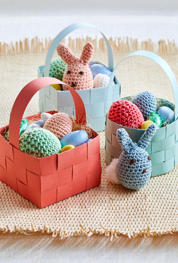 easter basket ideas crocheted bunnies and easter eggs inside baskets made from crepe paper